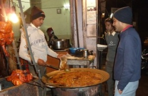 Taxi driver Ravi ordering authentic street food in Jaipur.